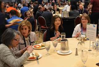 Conference attendees at lunch table